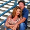 Bobbi and Larry sitting on steps before they were married