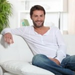 bigstock-Man-relaxing-at-home-sitting-o-21078464