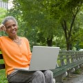 woman on laptop in central park