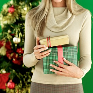 Young Woman Holding Christmas Gifts --- Image by © Royalty-Free/Corbis
