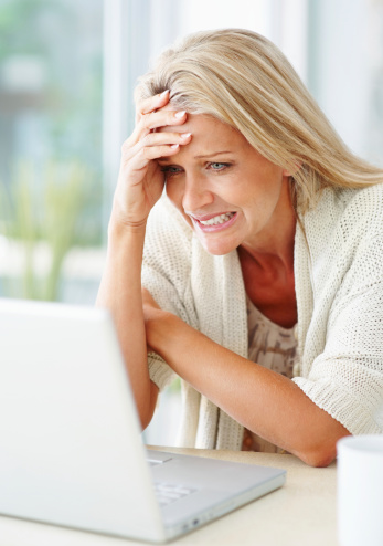 Woman at computer frustrated 121356236