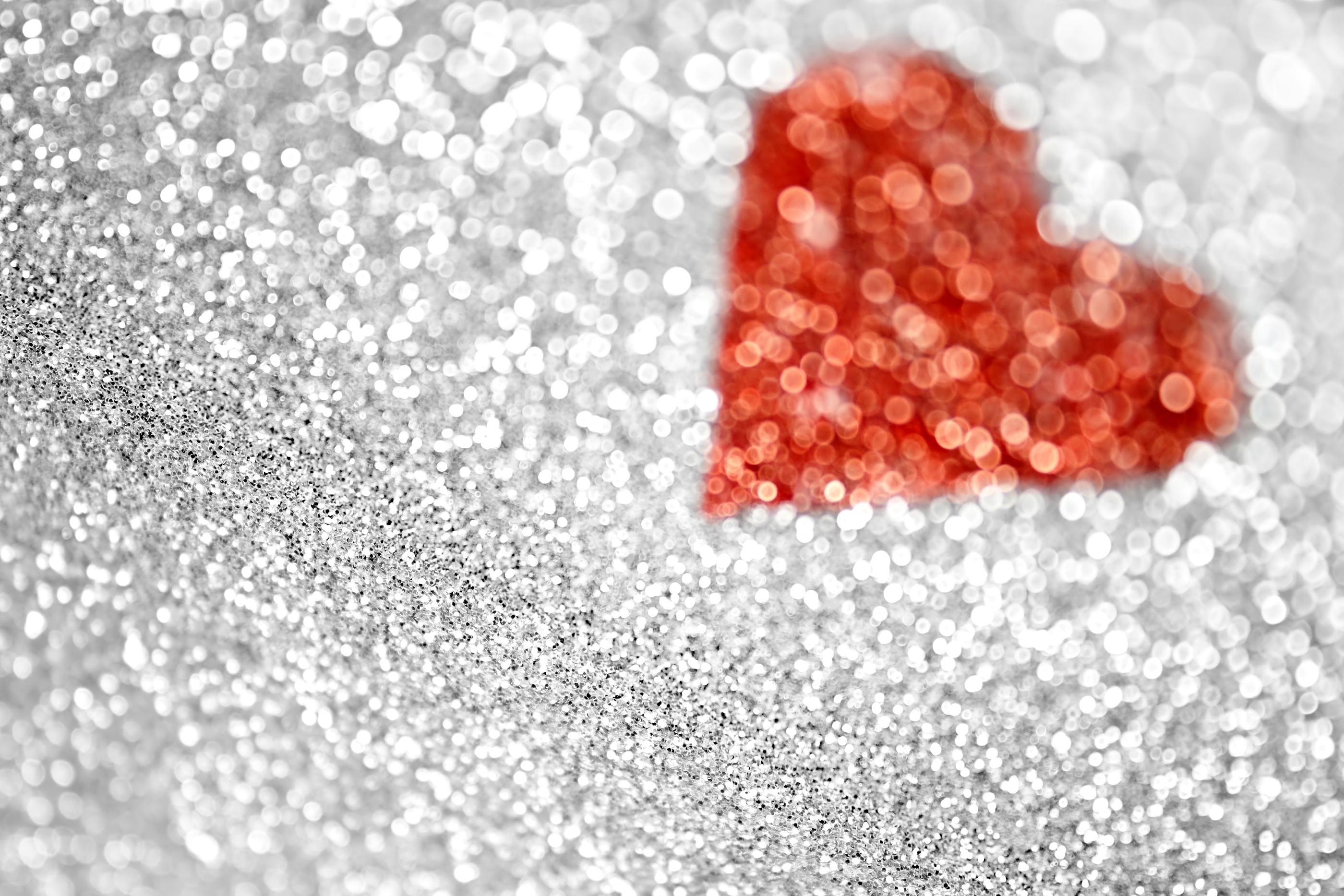 An abstract silver glitter and heart background ** Note: Shallow depth of field